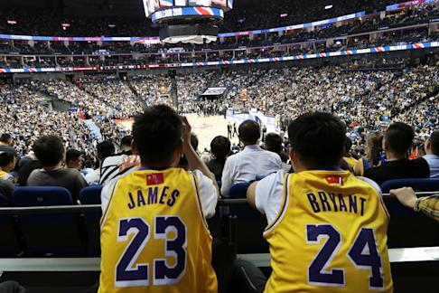 Fans look on at the game. Photo: Reuters