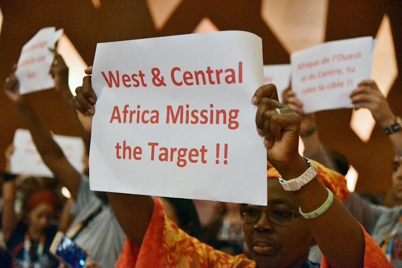 Delegates at ICASA's opening ceremonies held up placards demanding action (AFP Photo/SIA-KAMBOU)