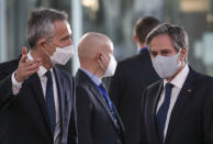 U.S. Secretary of State Antony Blinken, right, and and NATO Secretary General Jens Stoltenberg wear protective masks as they arrive for a news conference during a meeting of NATO foreign ministers at NATO headquarters in Brussels, Tuesday, March 23, 2021. (Yves Herman, Pool via AP)