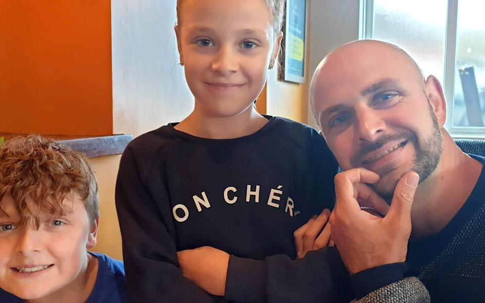 John Paul, 13, and Lacey, 11, with their father Jason Bennett