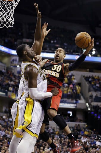 Atlanta Hawks' Dahntay Jones (30) is called for a foul against Indiana Pacers' Roy Hibbert (55) during the first half of an NBA basketball game, Monday, March 25, 2013, in Indianapolis. (AP Photo/Darron Cummings)
