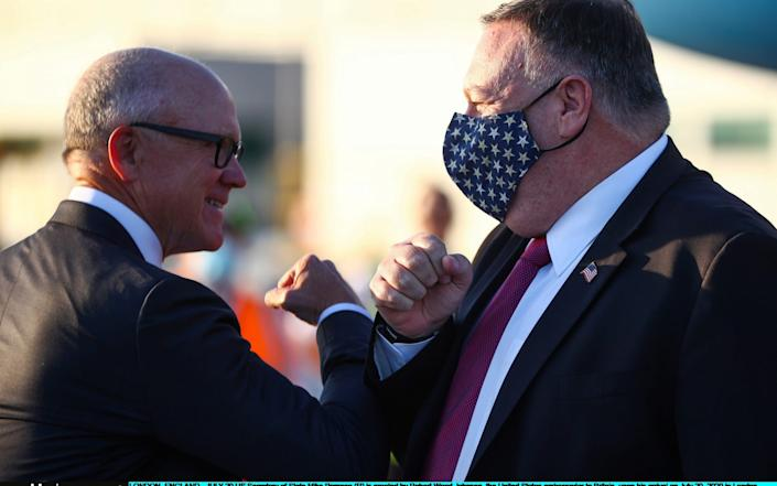 Mike Pompeo elbow-bumps Robert Wood Johnson, the United States' ambassador to Britain as he arrives yesterday - WPA Pool