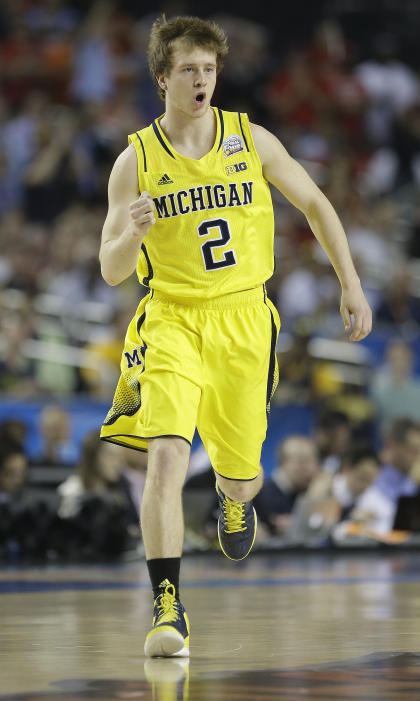 Spike Albrecht (2) reacts to a shot during Michigan's 2013 national championship loss to Louisville. (AP)