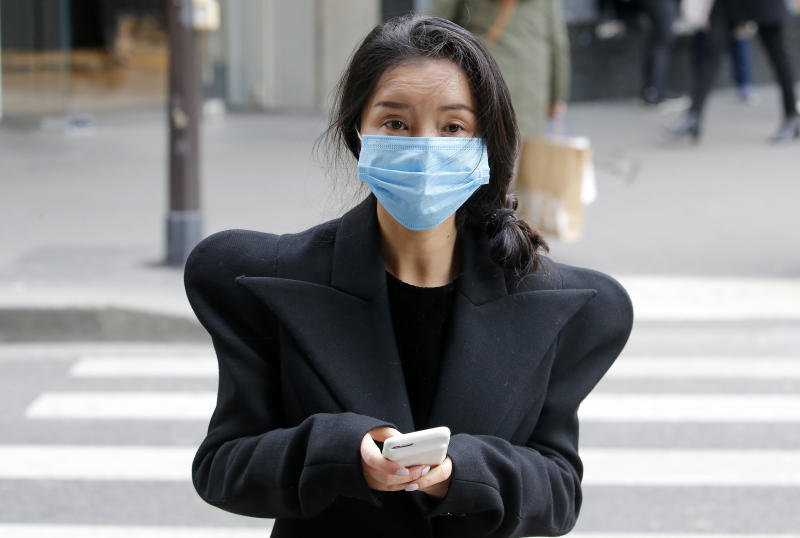 PARIS, FRANCE - MARCH 04: A woman wearing a protective mask looks on as walking the streets of Paris on March 4, 2020 in Paris, France. Due to a sharp increase in the number of cases of coronavirus (COVID-19) declared in Paris and throughout France, several sporting, cultural and festive events have been postponed or canceled. The epidemic has exceeded 3,000 dead for more than 86,000 infections in sixty countries. In France, 130 cases are now confirmed, in 13 regions in total. (Photo by Chesnot/Getty Images)