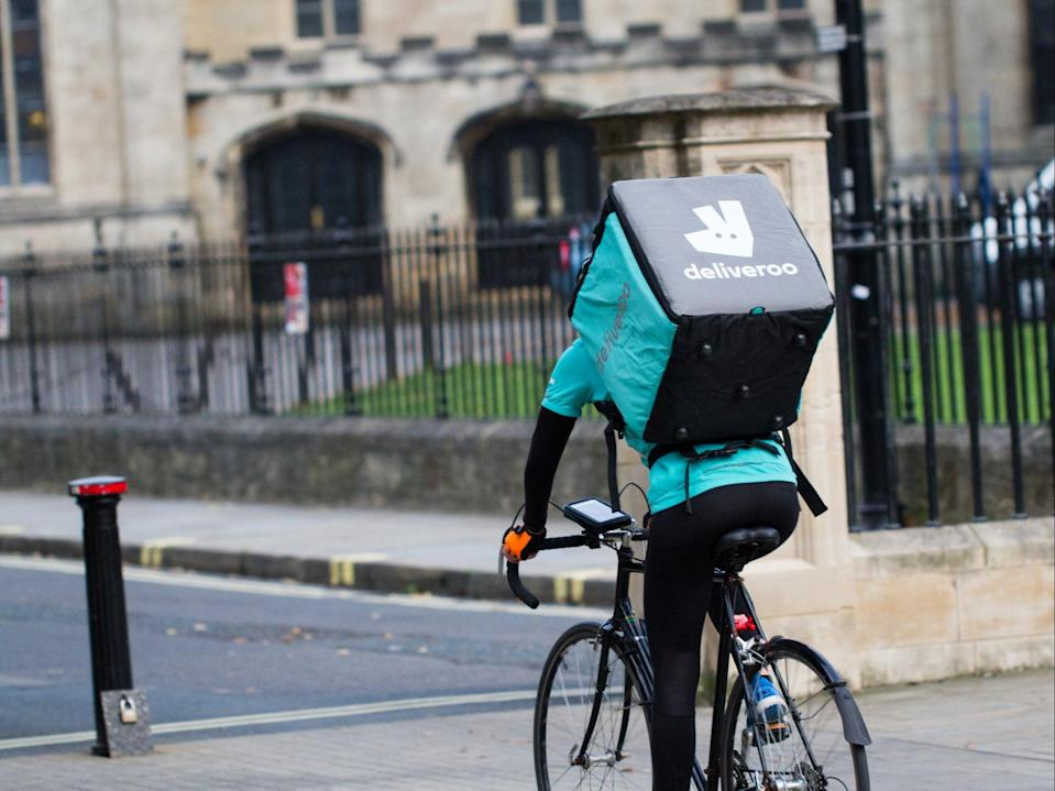 A Deliveroo rider on a bicycle (Getty Images)