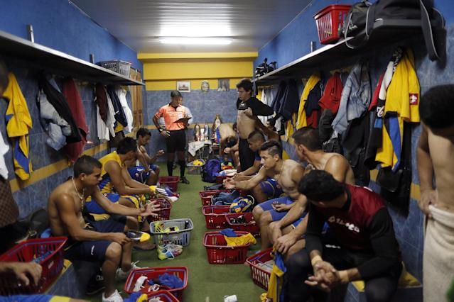 In this Oct. 18, 2014 photo, reserve soccer players from the Deportivo Capiata team prepare for a national league match against Cerro Porteno in Capiata, Paraguay. When Capiata, a soccer club formed six years ago in an Asuncion suburb, beat Boca 1-0 at its famed La Bombonera stadium in Buenos Aires, it was a shocker for the ages. (AP Photo/Jorge Saenz)