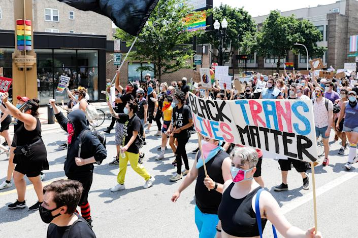 Protesters hold signs during the Pride Without Prejudice march in Boystown on 28 June 2020 in Chicago, Illinois. Demonstrators gathered to march for LGBT+ and Black Lives as protests continue across the nation ((Getty Images))