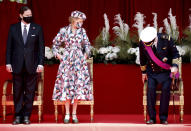 Belgium's Princess Delphine, center, her husband James O'Hare, left, and Belgium's Prince Laurent, right, take their places on the Royal tribune prior to the National Day parade in Brussels, Wednesday, July 21, 2021. Belgium celebrates its National Day on Wednesday in a scaled down version due to coronavirus, COVID-19 measures. (AP Photo/Olivier Matthys)
