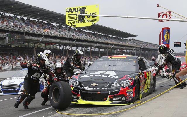Jeff Gordon pits during the Brickyard 400 auto race at Indianapolis Motor Speedway in Indianapolis, Sunday, July 27, 2014. (AP Photo/Robert Baker)