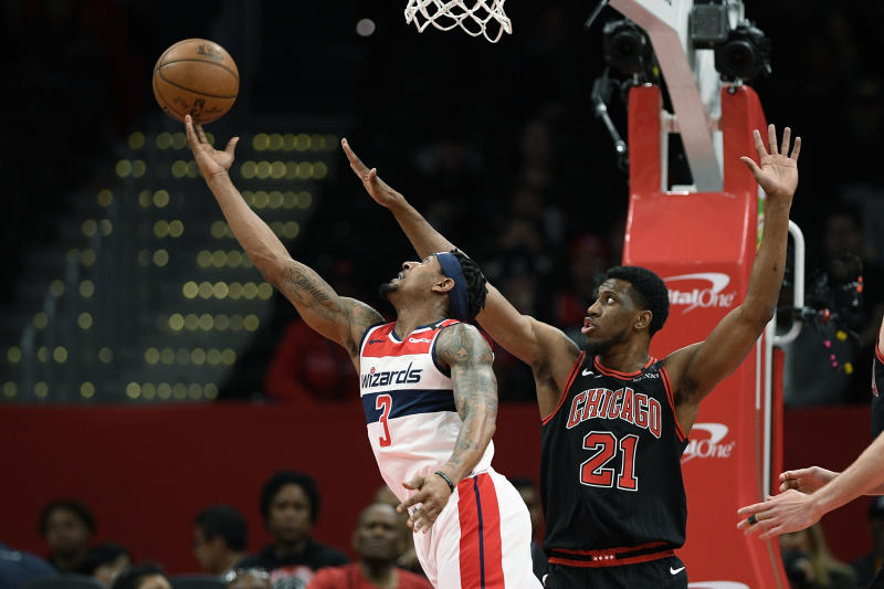 Washington Wizards guard Bradley Beal (3) goes to the basket next to Chicago Bulls forward Thaddeus Young (21) during the first half of an NBA basketball game, Tuesday, Feb. 11, 2020, in Washington. (AP Photo/Nick Wass)