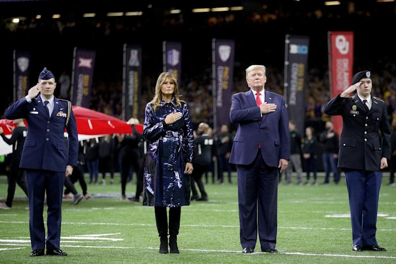 Melania Trump and Donald Trump put their hands over their hearts for the anthem (Getty Images)