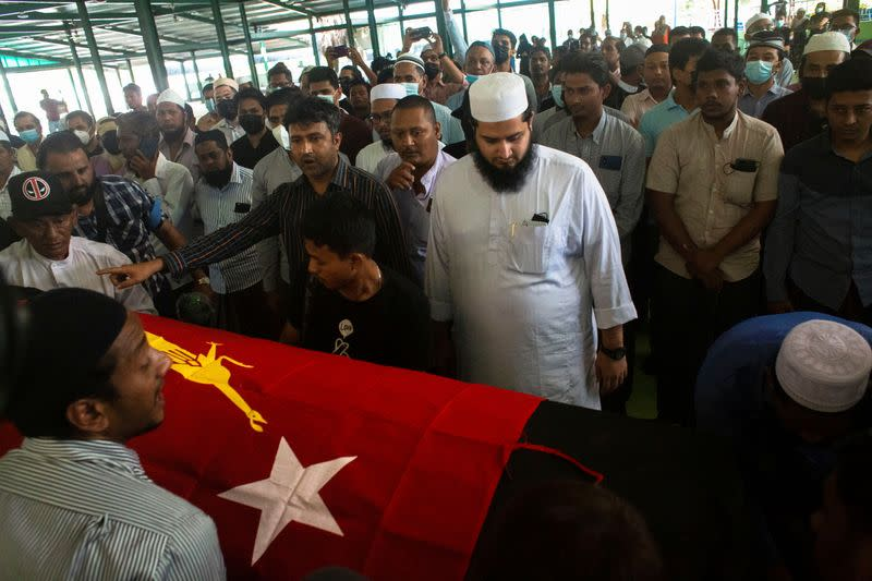 People attend at a funeral of NLD's ward chairman U Khin Maung Latt in Yangon