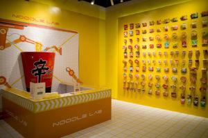 The playground's noodle lab and the wall of instant noodles. Photo: Carolyn Teo/Coconuts