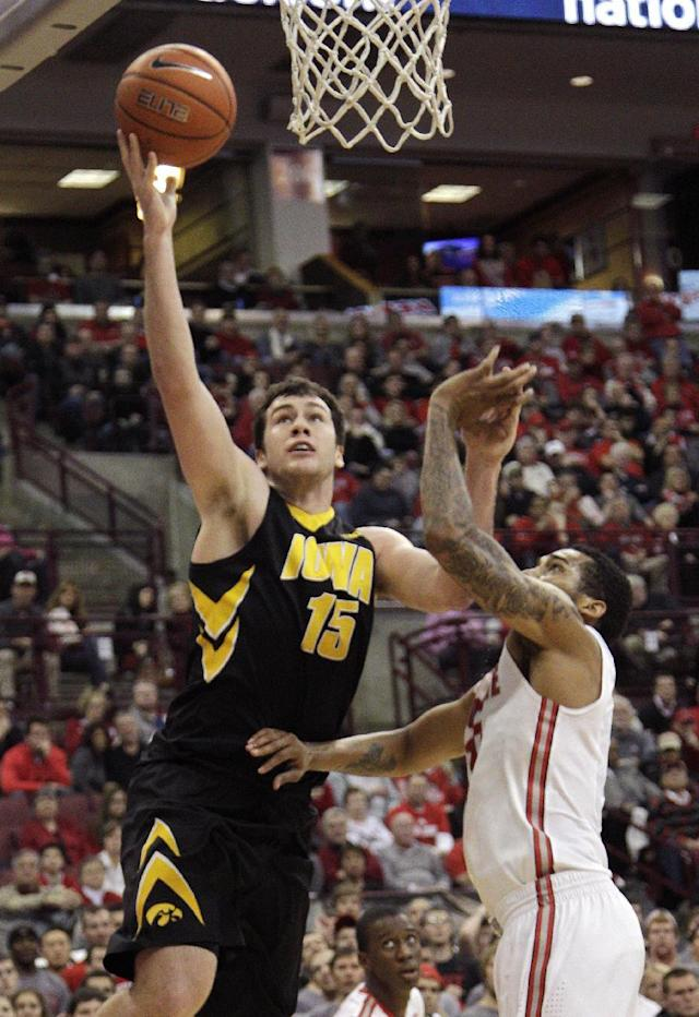 Iowa's Zach McCabe, left, shoots over Ohio State's LaQuinton Ross during the first half of an NCAA college basketball game on Sunday, Jan. 12, 2014, in Columbus, Ohio. (AP Photo/Jay LaPrete)