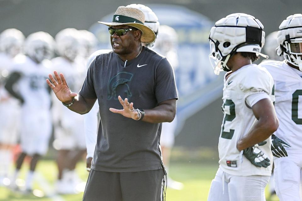 Michigan State's head coach Mel Tucker talks with the defensive backs during football camp on Tuesday, Aug. 17, 2021, on the MSU campus in East Lansing.