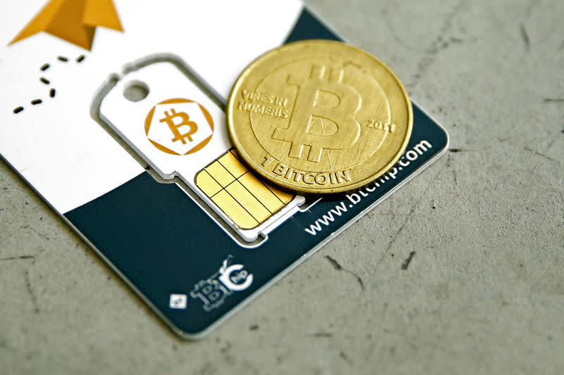 An illustration photo shows a Bitcoin (virtual currency) hardware wallet and a coin are seen in an illustration picture taken at La Maison du Bitcoin in Paris