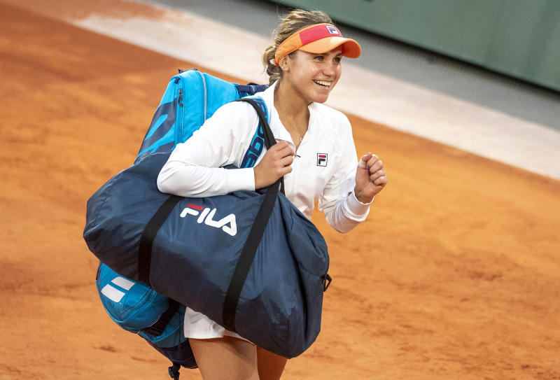 A smiling Sofia Kenin leaves the court after her victory against Petra Kvitova at the French Open.