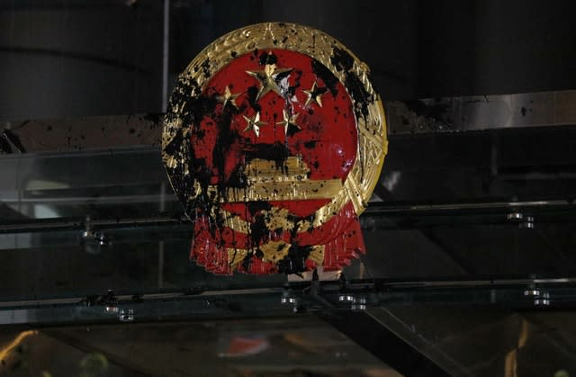 Protesters targeted the National Emblem of the People's Republic of China