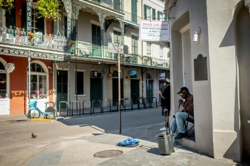 New Orleans' normally bustling French Quarter is eerily quiet, its music silenced and its bars and restaurants shuttered