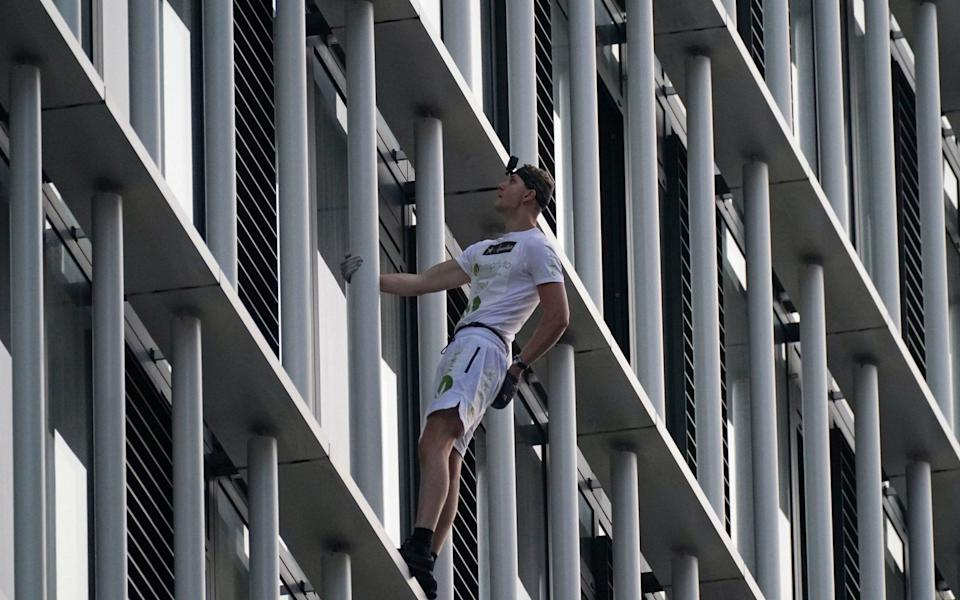 George King used nothing but his bare hands to climb the residential block in Stratford on Tuesday morning - Yui Mok/PA