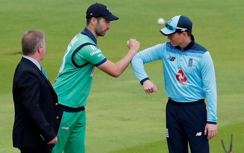 England's Eoin Morgan and Ireland's Andy Balbirnie touch arms - REUTERS