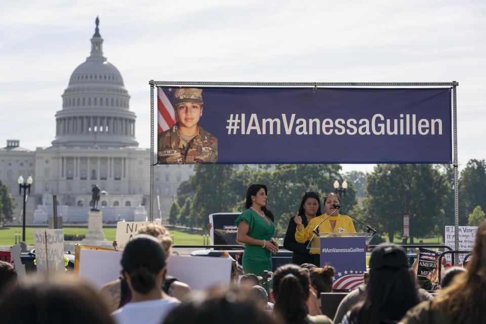FILE - In this July 30, 2020, file photo slain Army Spc. Vanessa Guillen's mother Gloria Guillen, right, joined by Vanessa's sister Lupe Guillen, center, and family attorney Natalie Khawam, speaks as she cries during a news conference on the National Mall in front of Capitol Hill in Washington. The Army said Friday, April 30, 2021, that it has taken disciplinary action against 21 officers and non-commissioned officers at Fort Hood, Texas, in connection with death last year of Spc. Vanessa Guillen, who was missing for about two months before her remains were found. (AP Photo/Carolyn Kaster, File)