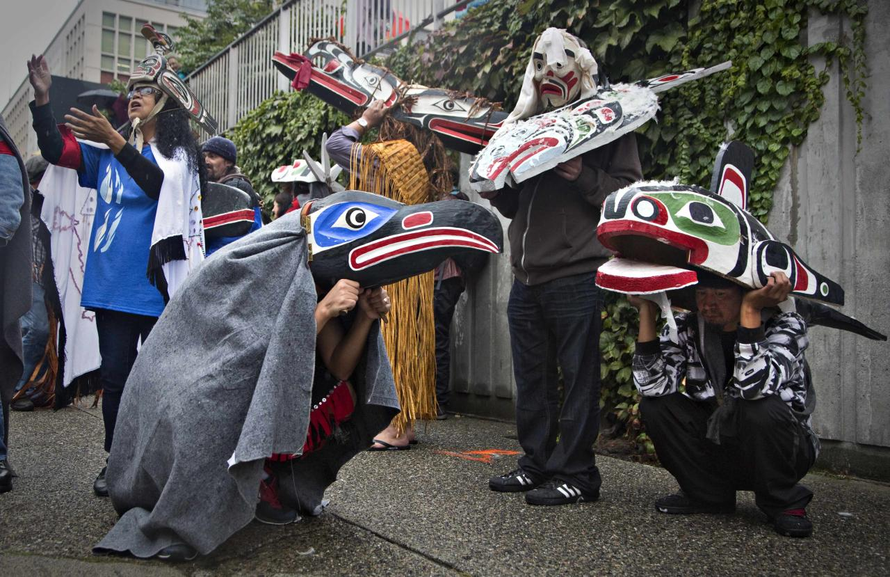 First Nations' participants wear traditional masks while waiting to take part in a Truth and Reconciliation march in Vancouver, British Columbia September 22, 2013. First Nations people, many survivors of the abuse at former Canadian Government Indian Residential Schools, have been meeting for the past week. REUTERS/Andy Clark (CANADA - Tags: SOCIETY)