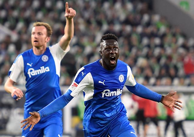 Soccer Football - Bundesliga Promotion/Relegation Playoff First leg - VfL Wolfsburg v Holstein Kiel - Volkswagen Arena, Wolfsburg, Germany - May 17, 2018 Holstein Kiel's Kingsley Schindler celebrates scoring their first goal REUTERS/Fabian Bimmer DFL RULES TO LIMIT THE ONLINE USAGE DURING MATCH TIME TO 15 PICTURES PER GAME. IMAGE SEQUENCES TO SIMULATE VIDEO IS NOT ALLOWED AT ANY TIME. FOR FURTHER QUERIES PLEASE CONTACT DFL DIRECTLY AT + 49 69 650050