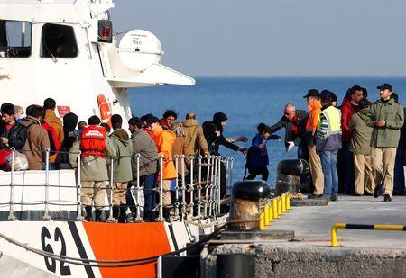 Migrants disembark from a Turkish coastguard boat after a failed attempt at crossing to the Greek island of Lesbos, in the Turkish coastal town of Dikili