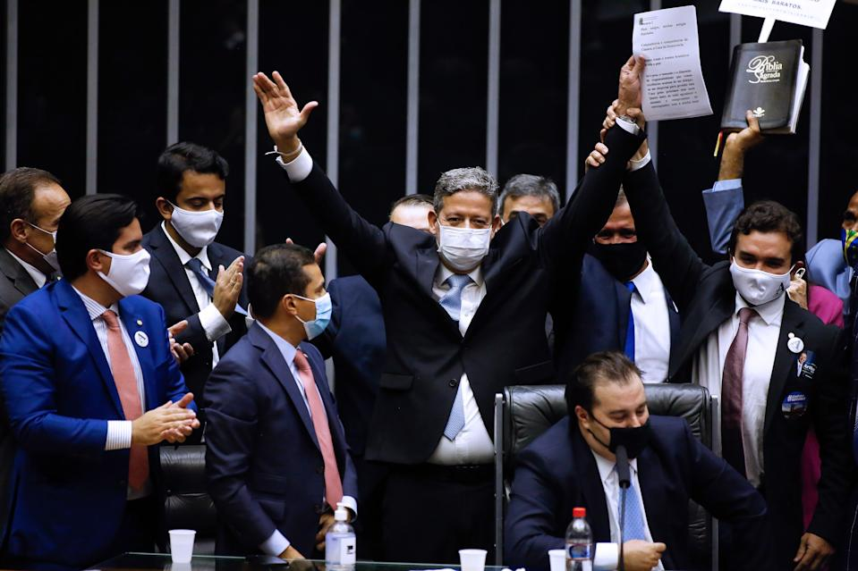 Brazilian Deputy Arthur Lira (C) celebrates after being elected as president of Brazil's Lower House in Brasilia on February 1, 2021. - Brazil's Congress on Monday elected Rodrigo Pacheco and Arthur Lira as Senate and Lower House's speakers respectively, both allies of far-right President Jair Bolsonaro. (Photo by Sergio Lima / AFP) (Photo by SERGIO LIMA/AFP via Getty Images)