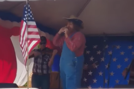 A singer, allegedly comedian Sacha Baron Cohen in disguise, performs an offensive song at a right-wing event in Washington: YouTube/screengrab