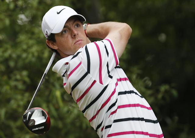 Rory Mcllory of Northern Ireland tees off the 8th hole during the first round of the HSBC Champions golf tournament at the Sheshan International Golf Club in Shanghai, China, Thursday, Oct. 31, 2013. McIlroy looked more like a two-time major champion Thursday when he opened with a 7-under 65 to build a two-shot lead in HSBC Champions. McIlroy was at his best around the turn when he made four birdies in a five-hole stretch. (AP Photo/Eugene Hoshiko)