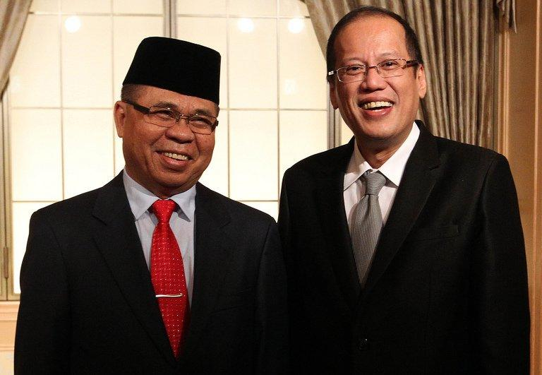 This file photo, taken on August 4, 2011, by Malacanang Photo Bureau and released by the Office of the Presidential Adviser on the Peace Process (OPAPP), shows Philippine President Benigno Aquino (R) posing for a photo with Moro Islamic Liberation Front (MILF) chairman Murad Ebrahim during their meeting in Tokyo
