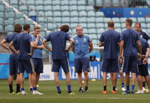 Sweden national soccer team players gather around head coach Janne Andersson, center, at the start of a training session on the eve of their Group F match against Germany, during the 2018 soccer World Cup in Sochi, Russia, Friday, June 22, 2018. (AP Photo/Rebecca Blackwell)