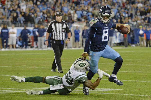 Tennessee Titans quarterback Marcus Mariota (8) gets out of the grasp of New York Jets inside linebacker Darron Lee (58) in the second half of an NFL football game Sunday, Dec. 2, 2018, in Nashville, Tenn. (AP Photo/Mark Zaleski)
