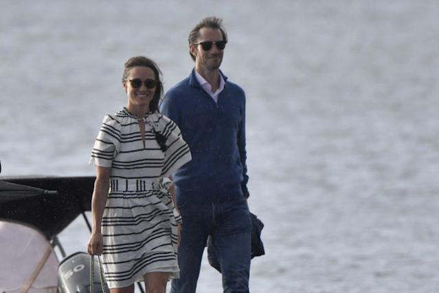 Pippa Middleton and James Matthews were seen braving the rain and wind as they touched down at Rose Bay, Sydney. (Photo: Splash)