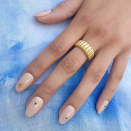 """<p>Add dainty gold stars to a neutral manicure. Place small red and blue dots in between the stars so that you'll look at home at the cookout. </p><p><a class=""""link rapid-noclick-resp"""" href=""""https://www.amazon.com/Stickers-Self-Adhesive-Metallic-Accessories-Decoration/dp/B08LT4SDPY/?tag=syn-yahoo-20&ascsubtag=%5Bartid%7C10055.g.1278%5Bsrc%7Cyahoo-us"""" rel=""""nofollow noopener"""" target=""""_blank"""" data-ylk=""""slk:SHOP GOLD NAIL JEWELRY"""">SHOP GOLD NAIL JEWELRY</a></p>"""