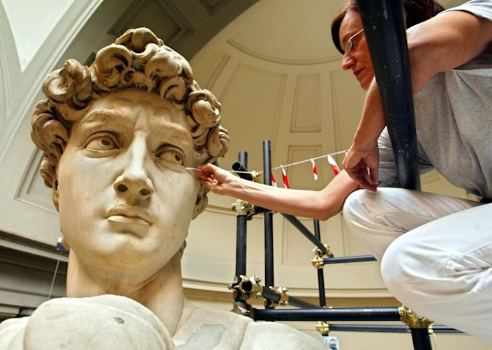 Italian restorer Cinzia Parnigoni works on cleaning one of the world's most famous statues in the world in 2003 at the Galleria del'Academia in Florence where the statue has been kept since 1873. The statue stands some 14 feet high.