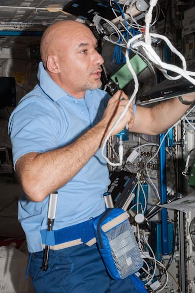 In this July 21, 2013 photo made available by NASA, European Space Agency astronaut Luca Parmitano speaks in a microphone while working in the Columbus laboratory of the International Space Station. The Italian astronaut who nearly drowned during a spacewalk in July 16, 2013 is sharing more details about the experience. Parmitano wrote in his online blog, posted Tuesday, Aug. 20, 2013 that he felt all alone as water filled his helmet outside the International Space Station. (AP Photo/NASA)