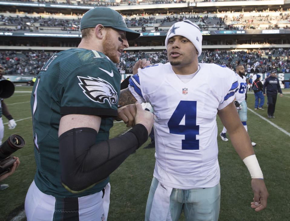 PHILADELPHIA, PA - JANUARY 1: Carson Wentz #11 of the Philadelphia Eagles hugs Dak Prescott #4 of the Dallas Cowboys after the game at Lincoln Financial Field on January 1, 2017 in Philadelphia, Pennsylvania. The Eagles defeated the Cowboys 27-13. (Photo by Mitchell Leff/Getty Images)