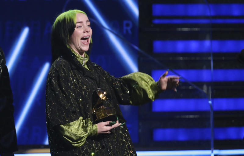 """Billie Eilish accepts the award for record of the year for """"Bad Guy"""" at the 62nd annual Grammy Awards on Sunday, Jan. 26, 2020, in Los Angeles. (Photo by Matt Sayles/Invision/AP)"""