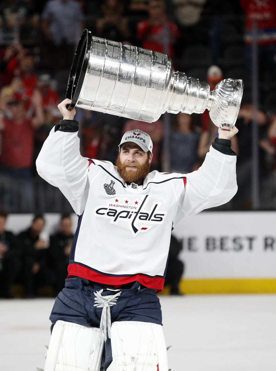 FILE - Washington Capitals goaltender Braden Holtby hoists the Stanley Cup after the Capitals defeated the Golden Knights 4-3 in Game 5 of the NHL hockey Stanley Cup Finals in Las Vegas, in this Thursday, June 7, 2018, file photo. Several goaltenders were on the move in NHL free agency Wednesday, July 28, 2021. Braden Holtby signed with the Dallas Stars (AP Photo/John Locher)