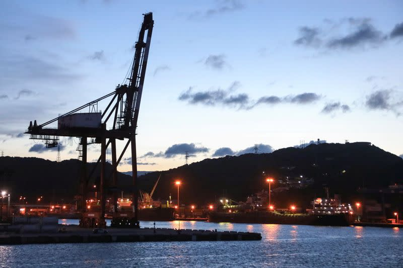 Cargo cranes are seen at Keelung Port during sunset hour in Keelung,