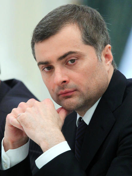 FILE - In this Wednesday, May 8, 2013 file photo Vladislav Surkov, an adviser to Russian President Vladimir Putin listens, during a meeting in Moscow, Russia. A former senior aide to Russian President Vladimir Putin has warned that Ukraine will never be able to regain control over the separatist-controlled east. Vladislav Surkov, who lost his job as Putin's adviser on Ukraine earlier this month, said in remarks published Wednesday that he stepped down because of a shift in the Kremlin course on the Ukrainian conflict. (Mikhail Klimentyev, Sputnik, Kremlin Pool Photo via AP, File)