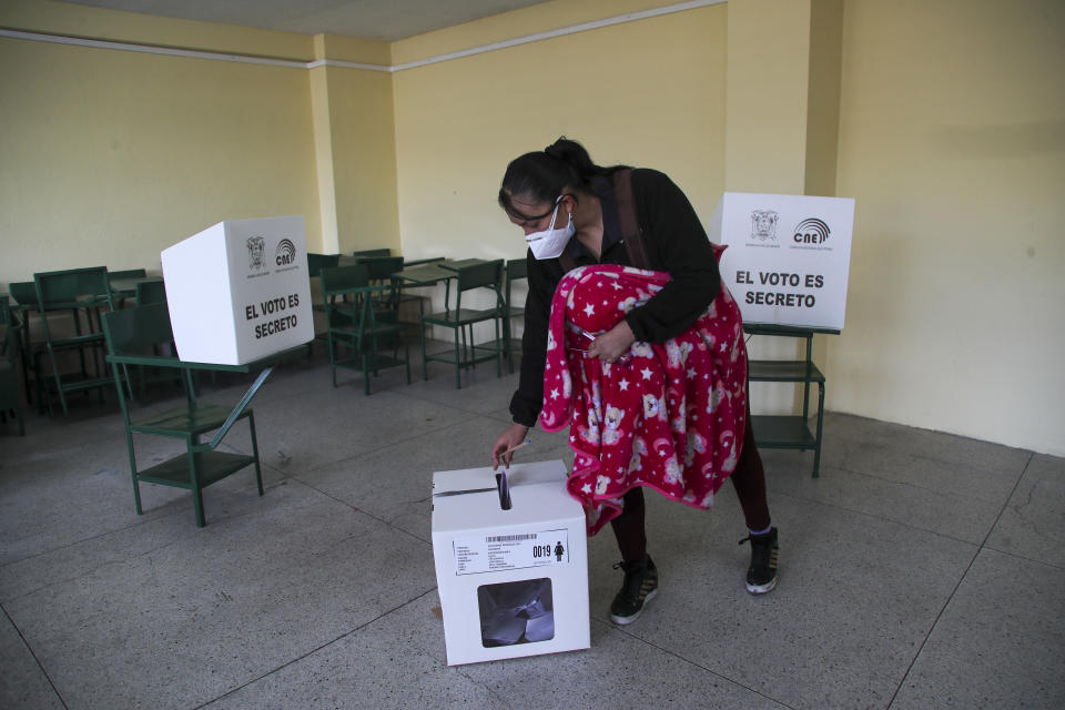 A woman votes during a runoff presidential election in Quito, Ecuador, Sunday, April 11, 2021. (AP Photo/Dolores Ochoa)