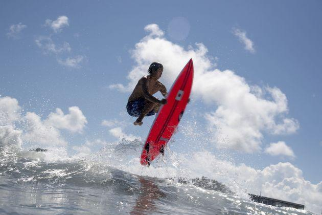 Japan's Kanoa Igarashi rides a wave during a free training session at the Tsurigasaki Surfing Beach. (Photo: OLIVIER MORIN via Getty Images)