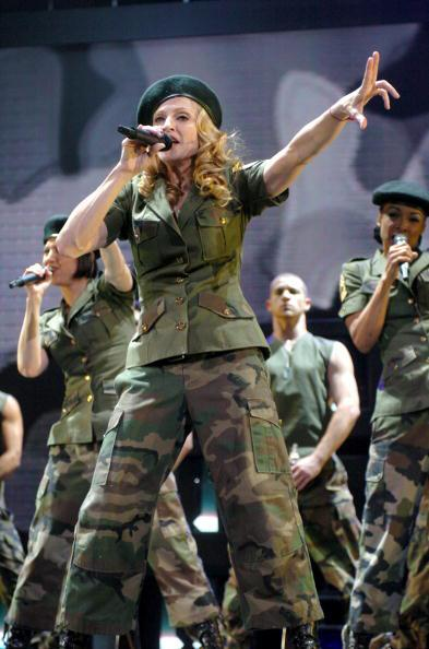 "<div class=""caption-credit""> Photo by: Getty Images</div><div class=""caption-title""></div><b>""Re-Invention"" Tour in New York, 2004</b> <br> Madonna schooled us on ""American Life"" (apparently it includes yoga, Pilates, and double shots of espresso) in full camo garb."