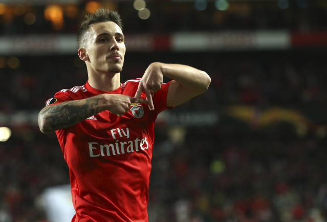 Benfica's Alex Grimaldo celebrates after scoring his side's third goal during the Europa League round of 16, second leg, soccer match between Benfica and Dinamo Zagreb at the Luz stadium in Lisbon, Thursday, March 14, 2019. (AP Photo/Armando Franca)