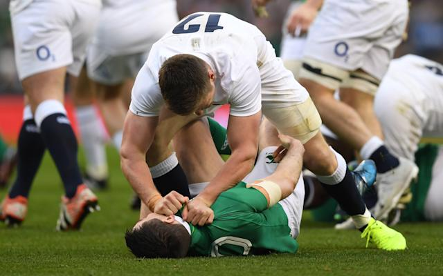 <span>Owen Farrell clashes with Jonathan Sexton</span> <span>Credit: Getty Images </span>