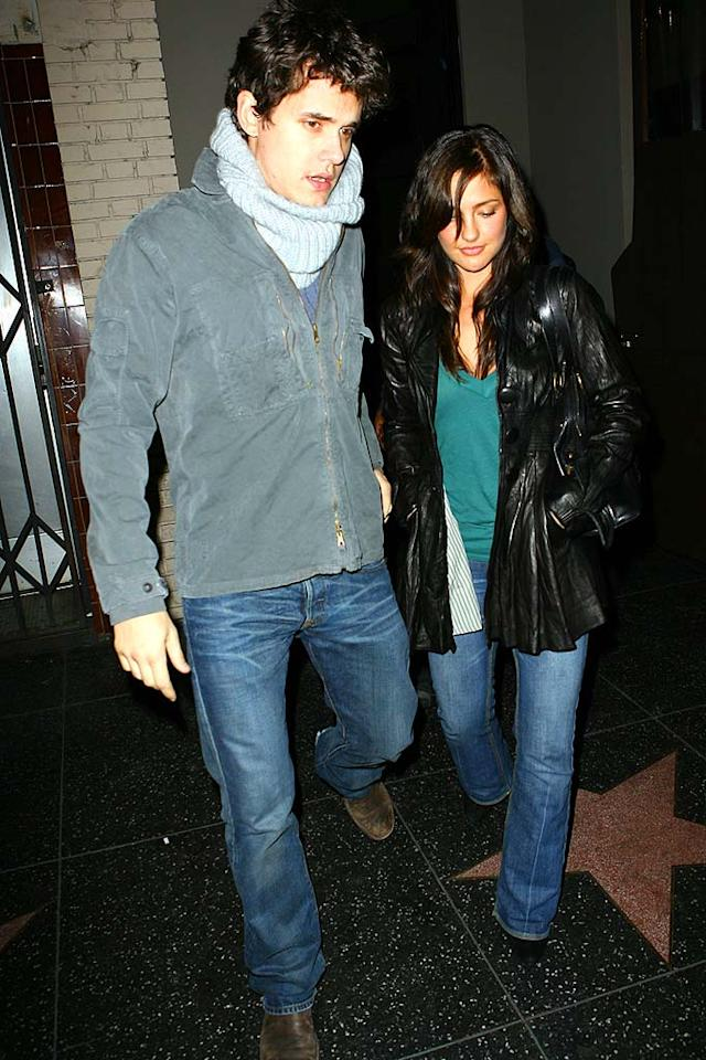 "John Mayer has adopted the over-sized scarf trend, while his rumored gal pal, Minka Kelly (""Friday Night Lights""), snuggles into a black leather jacket. AlphaX/<a href=""http://www.x17online.com"" target=""new"">X17 Online</a> - December 8, 2007"